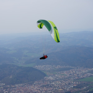 Green Chili flying over town